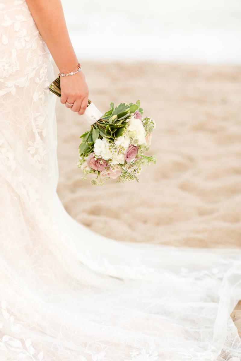 Bride holding bridal bouquet out
