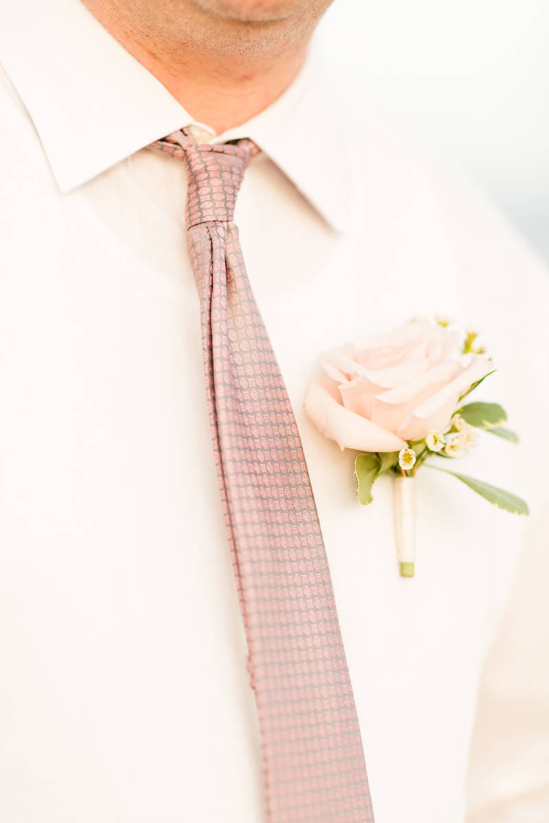 up close image of pastel pink boutonniere