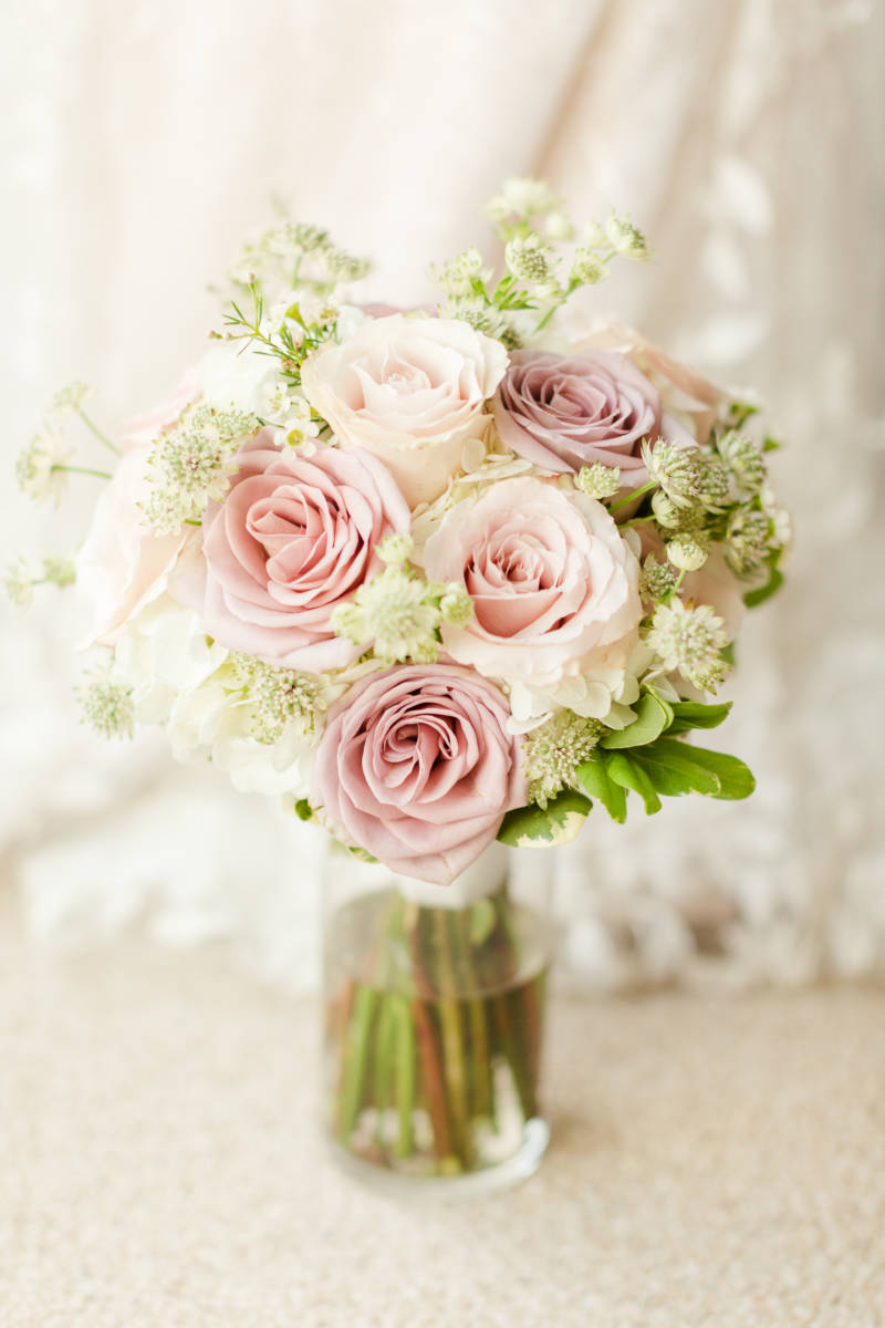 Outer Banks florals Bridal bouquet elegant pastel pink roses with small white flowers and greenery in a vase