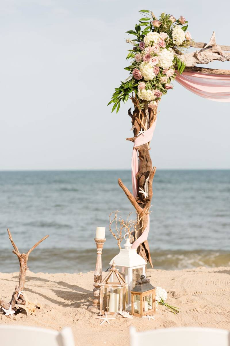 Outer Banks Wedding Arch with Florals and lantern decor